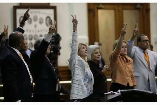 Texas - Democrats turn to the Sea of Orange holding up two finger for NO to SB5