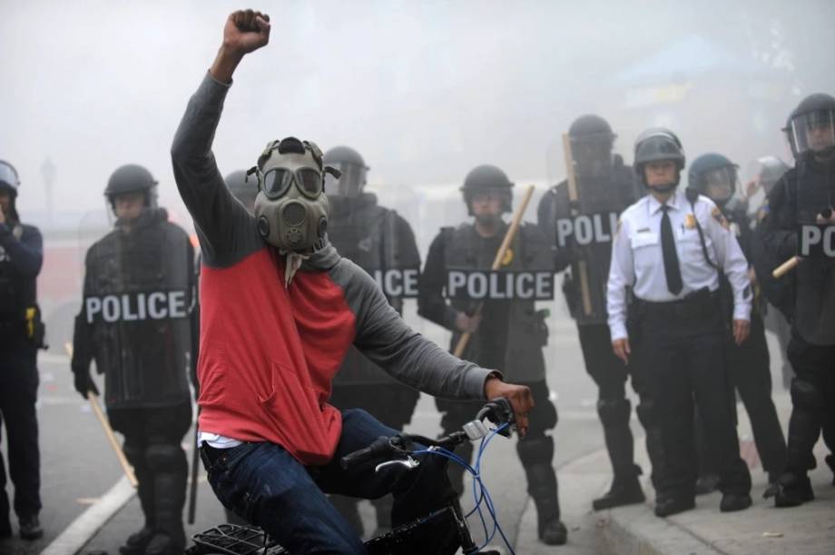 Protester and Police -  Baltimore Riots