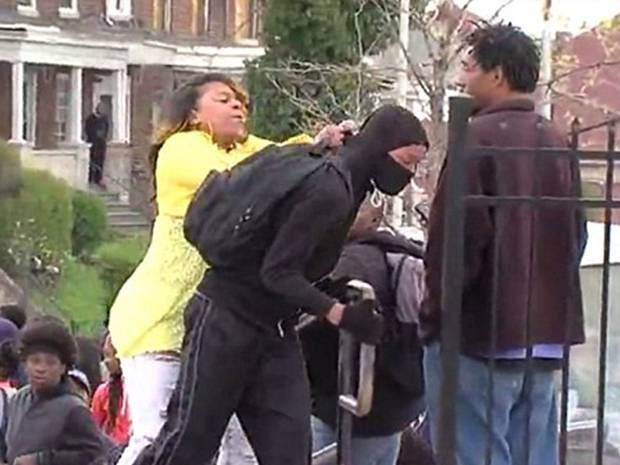 Furious mother marches her son home from Baltimore riots...