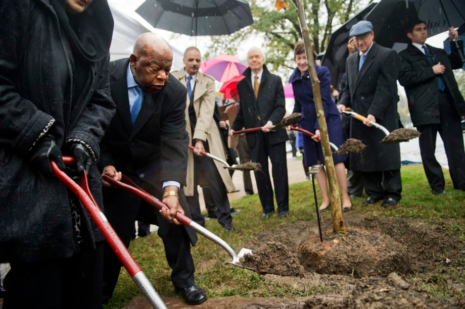 UNITED STATES - NOVEMBER 17: From left, Rep. John Lewis, D-Ga., Attorney General Eric Holder, Sens. Thad Cochran, R-Miss., Susan Collins, R-Me., and Roger Wicker, R-Miss., participate in a tree-planting ceremony on the Capitol grounds November 17, 2014. The tree, which is near Constitution Avenue, is in honor of Emmett Till, a young African-American man who was murdered in 1955. (Photo By Tom Williams/CQ Roll Call)