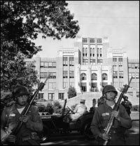Federal troops stand guard in front of Central High School, in Little Rock, Ark., in September 1957 after federal courts ordered the enforcement of desegregation laws. © Bettmann/Corbis