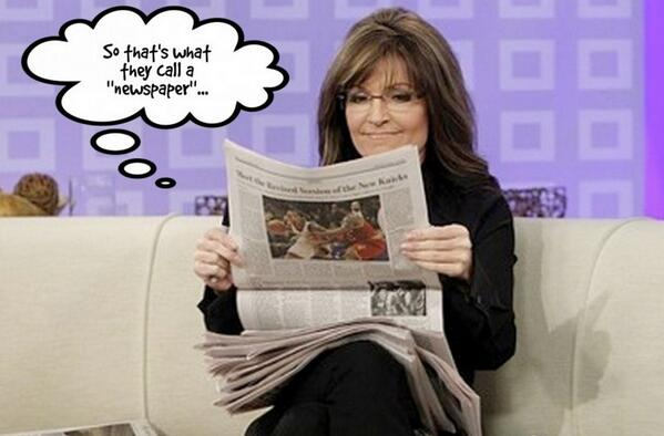 Sarah Palin reads newspaper